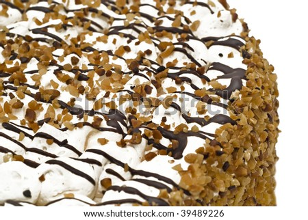 Close-up of tasty birthday cake with cream, nuts and chocolate (shallow DOF) - stock photo