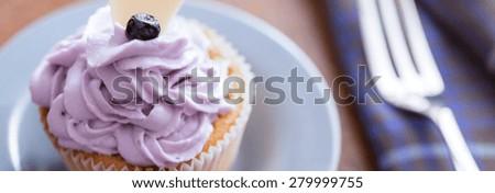 Close-up of tasty cakes with blueberry mascarpone cream - stock photo