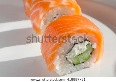 Close up of tasty fresh sushi rolls on plate - stock photo