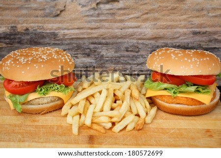 Close up of tasty hamburger and french fries