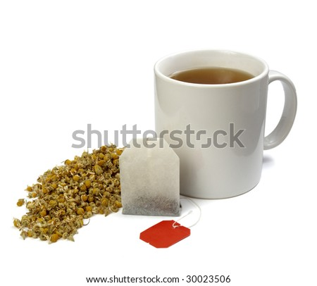 close up of tea bag, chamomile plant  and coffee cup on white background with clipping path, shadow is not included