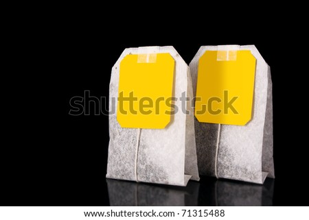 Close-up of tea bag  on black background - stock photo