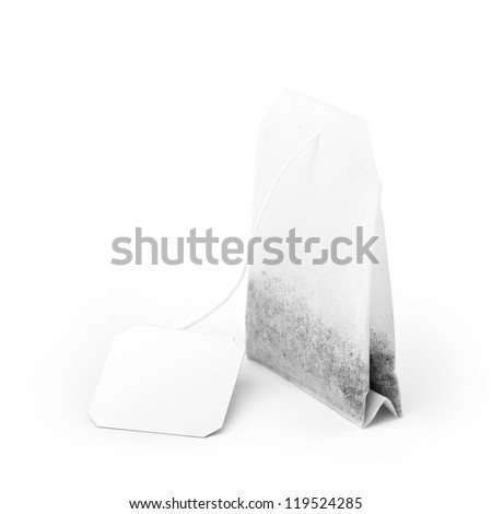 Close-up of tea bag with white label isolated on white background, soft shadow. Included clipping path and path for label - stock photo