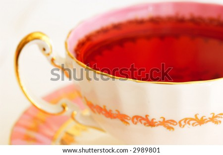 close up of tea cup on white