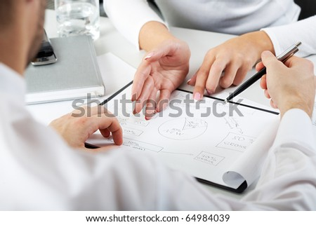 Close-up of team working with documents at business meeting - stock photo