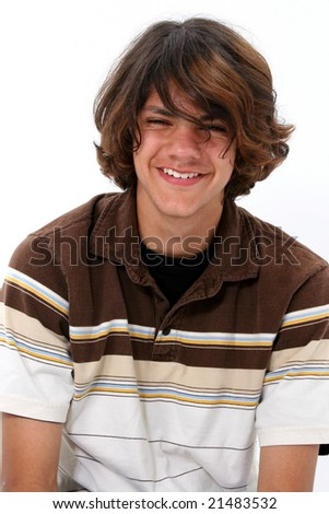 Close up of teen boy smiling. - stock photo