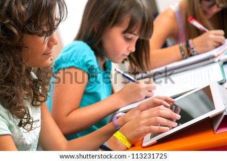Close up of Teenage girls doing homework. - stock photo