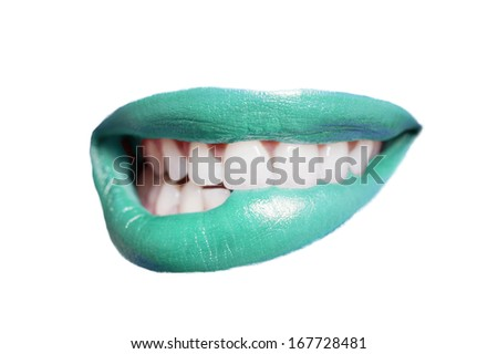 Close-up of teeth biting colored lip over white background - stock photo