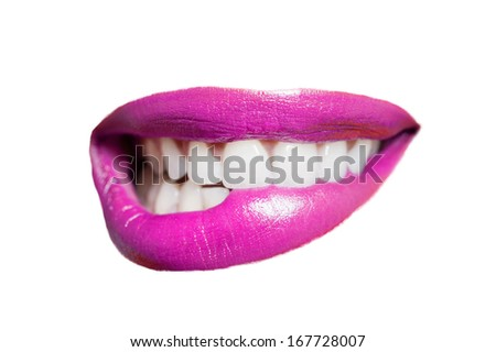 Close-up of teeth biting pink lip over white background