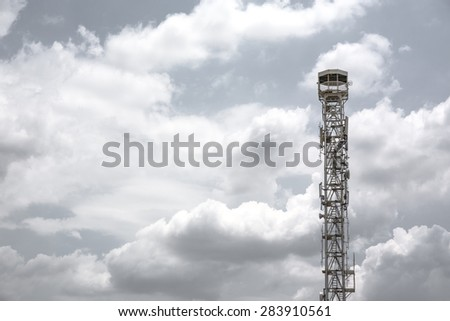 close-up of telecommunications tower on white sky background - stock photo