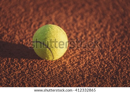 Close up of tennis ball. green color tennis ball on a tennis court. - stock photo