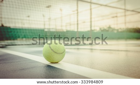 Close up of tennis ball. green color tennis ball. single tennis ball. tennis ball from Thailand. tennis ball vintage tone. the new tennis ball. beautiful tennis ball. Tennis ball on a tennis court - stock photo