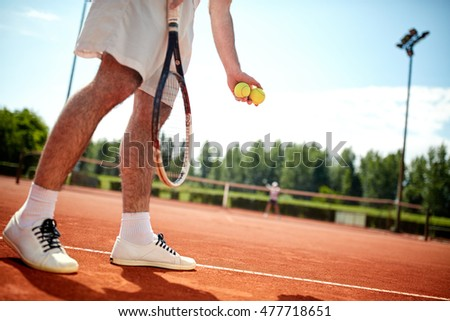 Close up of tennis playerâ??s legs serving on tennis court