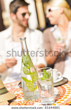 Close-up of terrace italian style refreshment table elegant romantic couple - stock photo