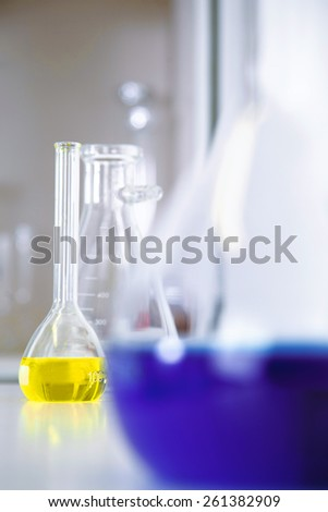 Close up of test tubes and pipette - stock photo