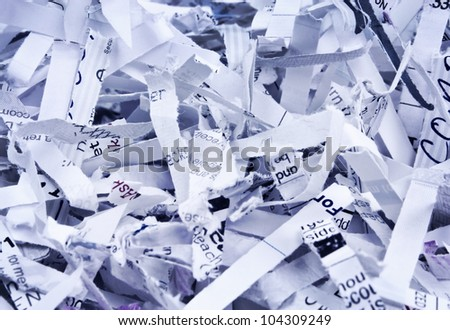 Close up of textured heap of shredded confidential papers with blue overlay with copy space. - stock photo