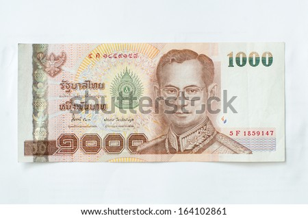 Close up of thailand currency, thai baht with the images of Thailand King. Denomination of 1000 bahts. - stock photo