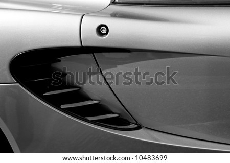 Close up of the air scoop on a metal-fleck silver automobile - stock photo