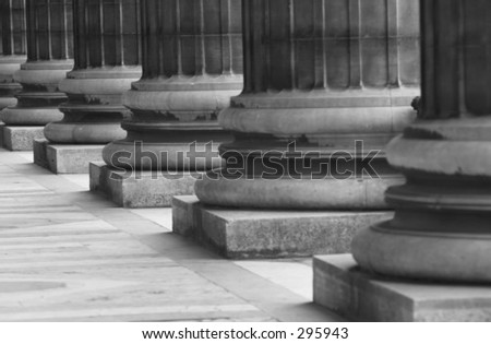 Close-up of the bases of an array of pillars, Paris, France (black and white),