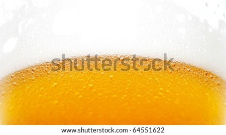 Close up of the beer bubbles in the glass - stock photo