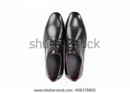 Close-up of  the black elegant man's shoes isolated on white background. - stock photo