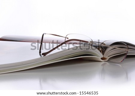 Close up of the book with glasses