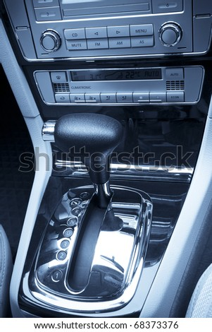 close up of the car gearshift and control panel - stock photo