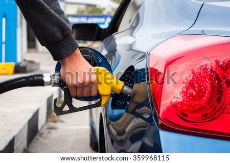 Close-up of the car refueling with gasoline - stock photo