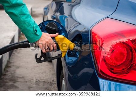 Close-up of the car refueling with gasoline