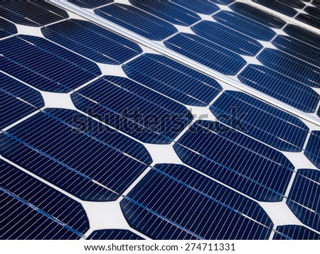 Close up of the cells of a solar panel installed on the roof of a house - stock photo
