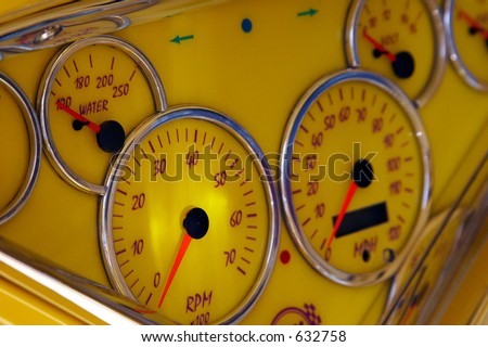 Close-up of the classic car yellow dashboard