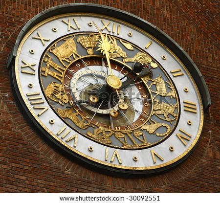 Close-up of the clock of Oslo City Hall - stock photo
