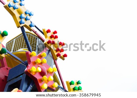 Close up of the colorful stars on a ferris wheel in children's theme park with free space. - stock photo