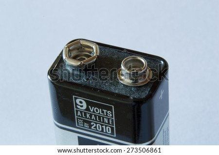 Close up of the connectors on top of a 9 volt battery - stock photo