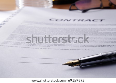 close-up of the contract document and pen - stock photo