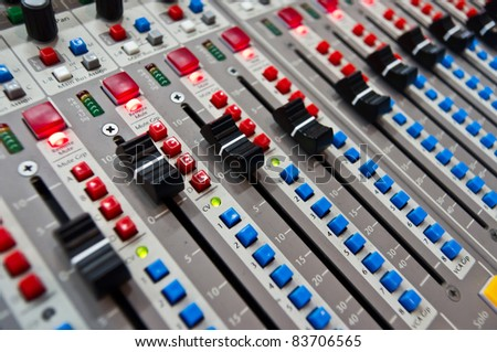 close up of the control panel of an audio mixer - stock photo