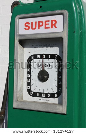 Close up of the dial of an old gas/petrol pump near an old garage. - stock photo