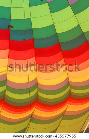close up of the different colors of a hot air balloon being inflated or deflated - stock photo