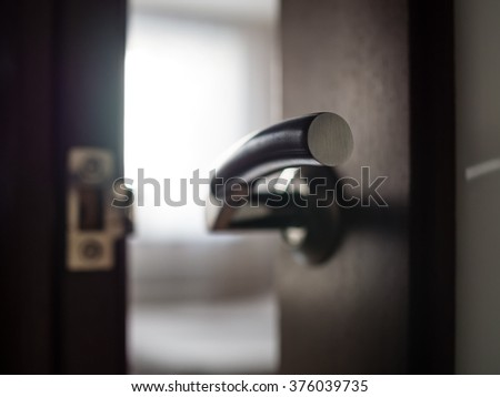 Close up of the door handle, shallow depth of field - stock photo