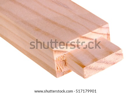 Close-up of the end of a pine board with a freshly cut woodworking tenon isolated against a white background