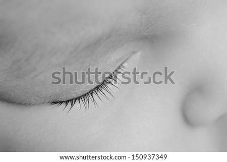 Close up of the eyelash of Newborn baby  sleeping. Black and White. - stock photo