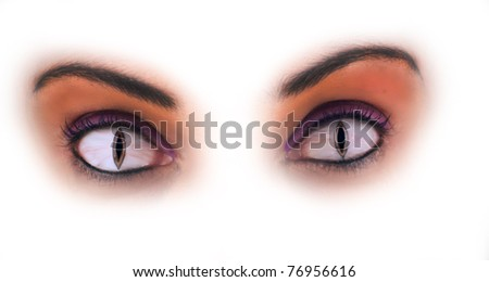 Close-up of the eyes of a beautiful mature black woman, manipulated to look like snake or cat eyes, isolated on a white background. - stock photo