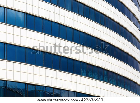 Close-up of the facade of modern building of steel and glass. Modern industrial architecture. - stock photo