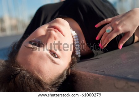 Close-up of the face of a pretty girl posing outdoors - stock photo
