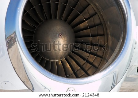 Close up of the fan blades inside a jet engine