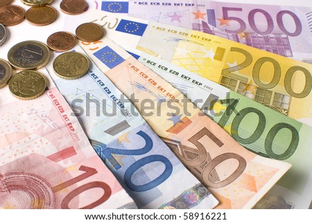 Close-up of the fan of 5, 10, 20, 50, 100, 200 and 500 Euro banknotes and coins. Isolated on a white background - stock photo