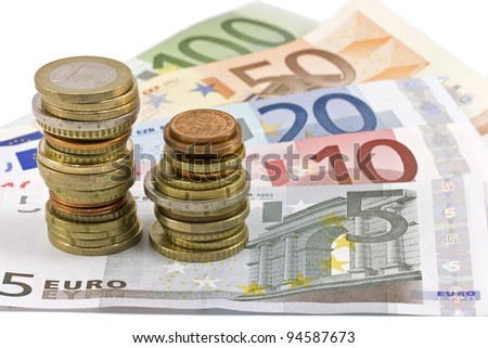 Close-up of the fan of 5, 10, 20, 50, 100, Euro banknotes and coins on white background - stock photo