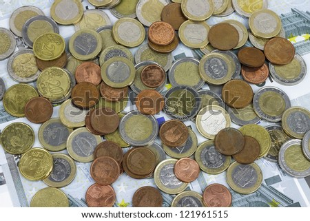 Close-up of the fan of 5, Euro banknotes and coins textures - stock photo