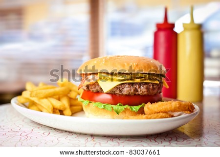 Close up of the fresh hamburger with french fries. - stock photo