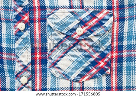 Close up of the front of a thick tartan shirt - stock photo